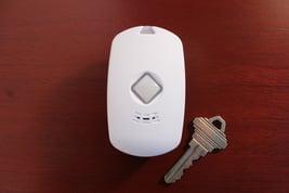 fall_detection_pendant_next_to_house_key_Ankota_Home_Care_blog